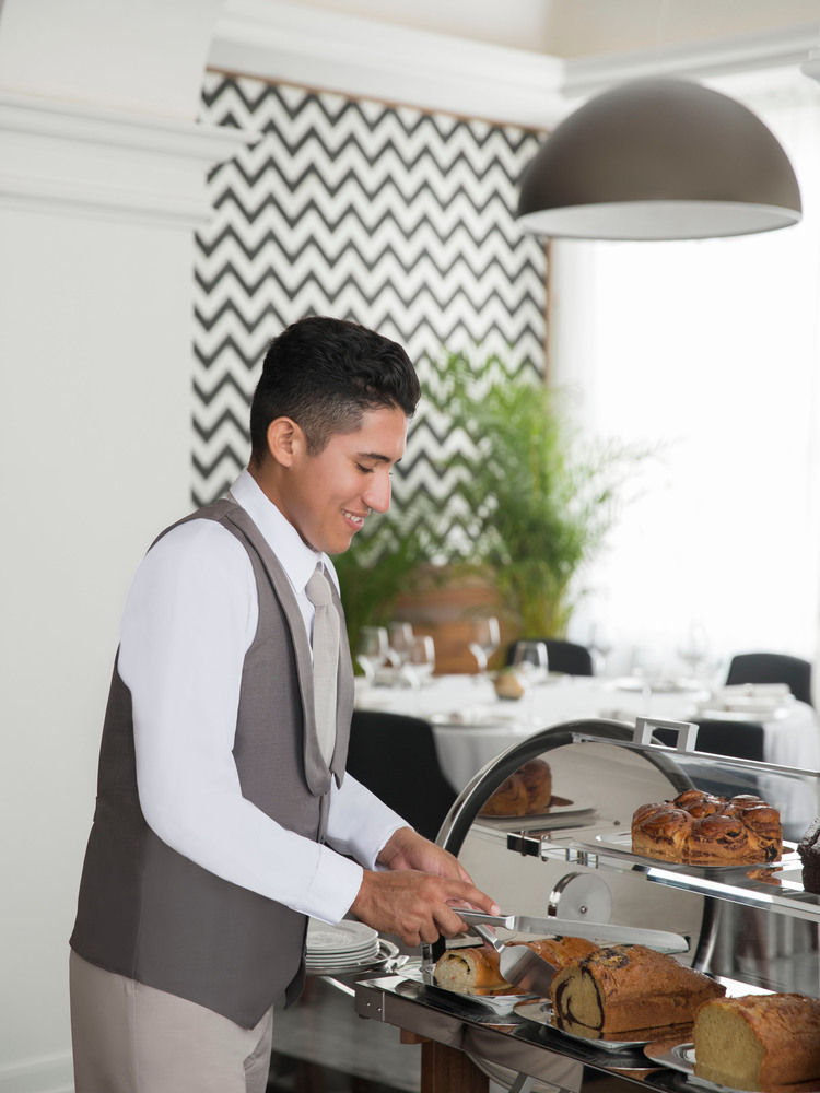Waiter Serving Bread at a Resort Restaurant